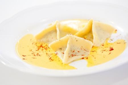 Three ravioli served on white plate Stock Photo - 18702310