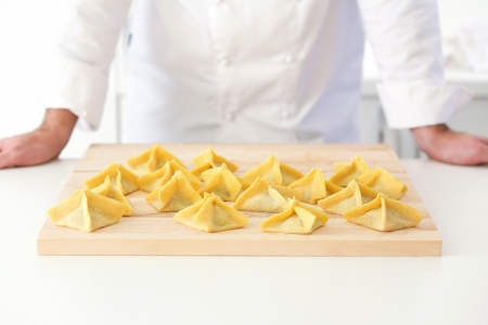 Raw ravioli on wooden board Stock Photo - 18702309