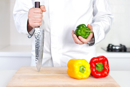 Chef holding knife and pepper Stock Photo - 19599883