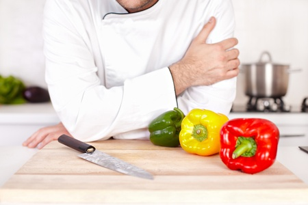 Chef with knife in the kitchen Stock Photo - 19599881