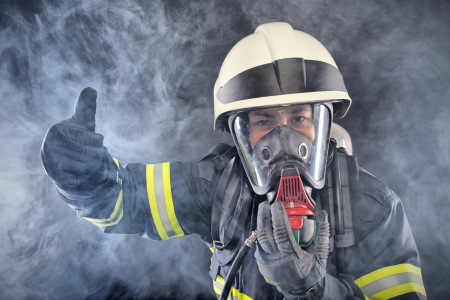 firefighter: Firewoman in fire protection suit and mask