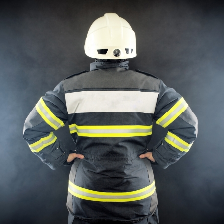 Back view of a fireman in protective suit wearing helmet Stock Photo - 19588393