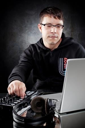 music production: DJ posing in studio
