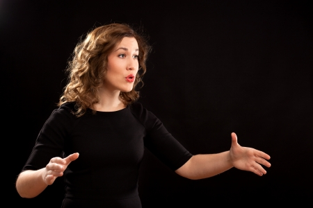 coro: Mujer director de coro durante la ejecución