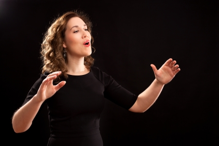 Female choir conductor during performance