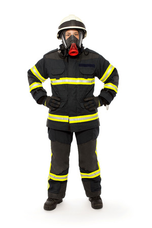Firefighter with mask and  protective suit  isolated on white background  photo