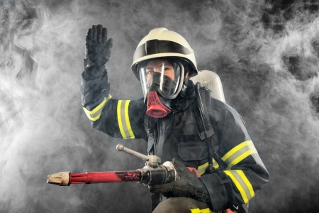 Firefighter giving directions in burning place