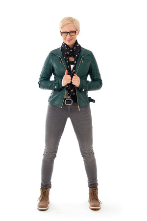 Ordinary young woman standing in casual outfit photo
