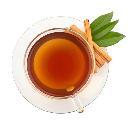 Top view of tea with cinnamon in glass cup