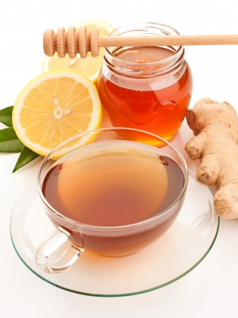Tea in glass cup with honey, lemon and ginger Stockfoto