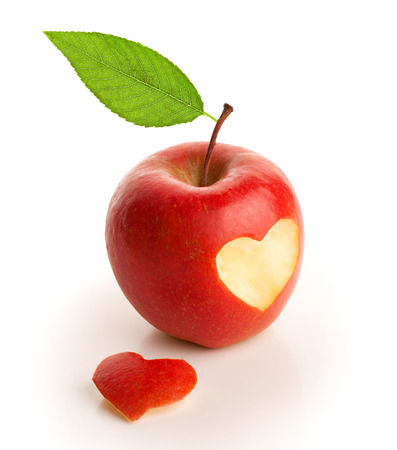 Red apple with cut heart isolated on white