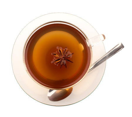 Top view of tea in glass cup with anise and spoon photo