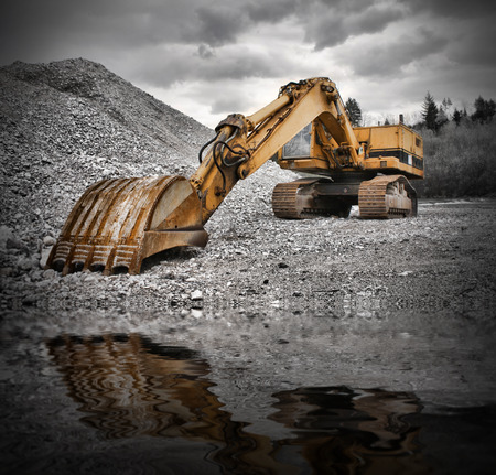 earth mover: Earth Mover near water pond Stock Photo