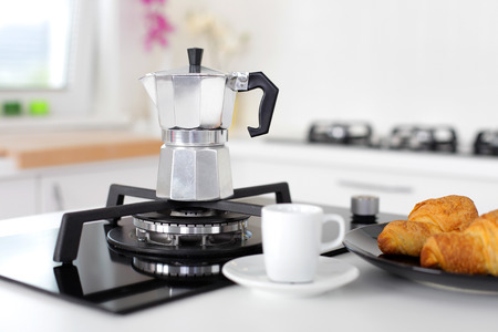 gas flame: Italian coffee maker above kitchen gas flame Stock Photo