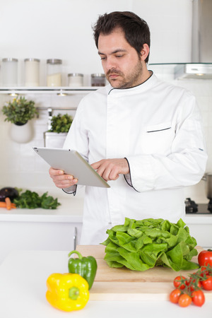 Chef looking for online recipe photo