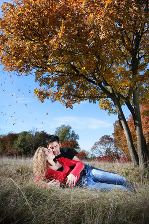 Couple in love in autumn under the tree photo