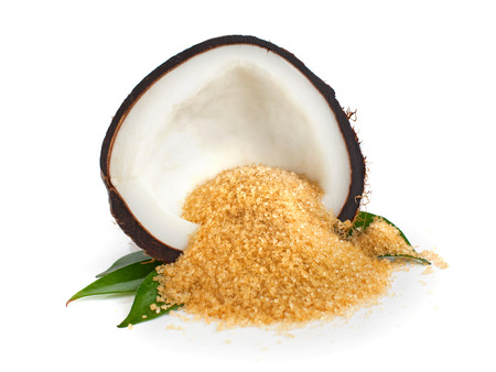 Coconut half and coconut sugar on white