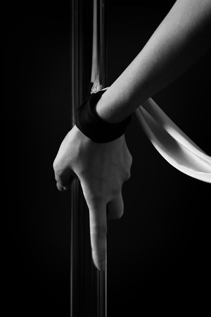 black grip: Grip of a pole dancer in black and white Stock Photo