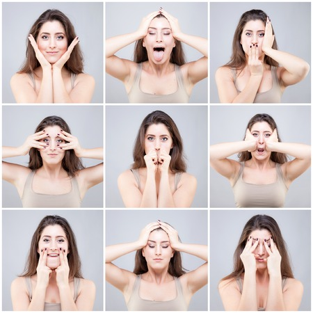 acupressure hands: Beautiful young caucasian woman doing face yoga pose Stock Photo