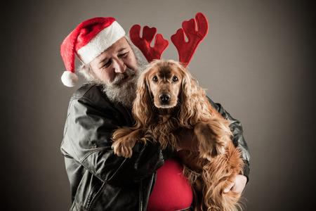 Badass Santa with dog as rudolph the reindeer Stock Photo