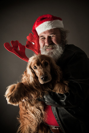ass christmas: Santa Claus  with his dog as Rudolph the Reindeer