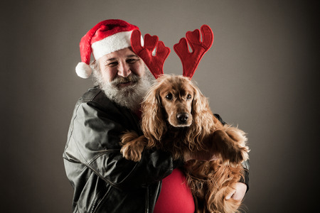 Santa Claus  with his dog as Rudolph the Reindeer
