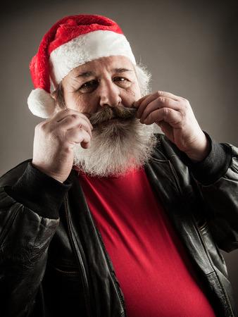big ass: Funny mature man with real beard dressed as Santa Claus Stock Photo