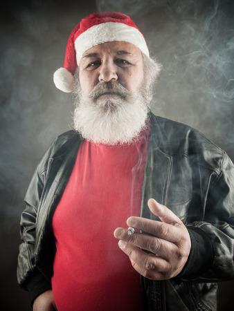 ass christmas: Grumpy badass Santa Claus with cigarette Stock Photo