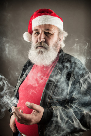 big ass: Grumpy badass Santa Claus with cigarette Stock Photo