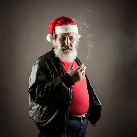 grumpy: Grumpy badass Santa Claus with cigarette Stock Photo