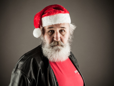 ass christmas: Funny mature man with real beard dressed as Santa Claus Stock Photo