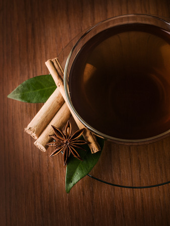 cinammon: Top view of tea cup with cinammon and anise