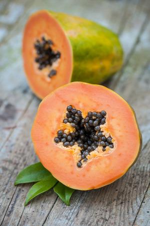 papaya fruit on wooden board Stock Photo