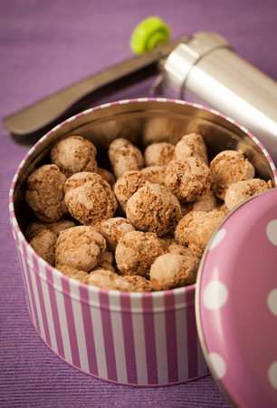 tin can: Home made coconut cookies in tin can
