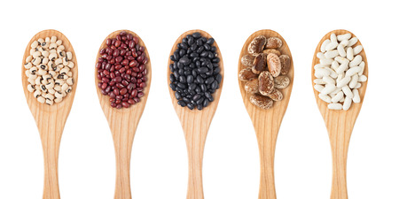 sorts: Different sorts of beans on wooden spoon isolated on white