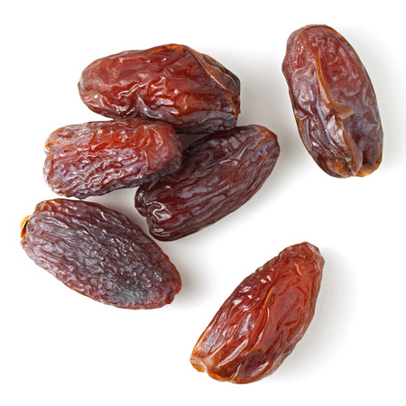 Medjool dates from above isolated on white background Stockfoto