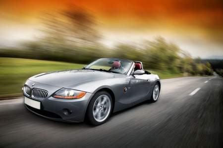 fast car: The BMW Z4 E89is a rearwheel drive sports car by the German car maker BMW man driving Z4 fast on the karst road in Slovenia EU