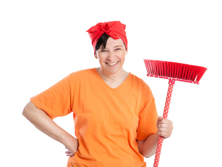 house maid: Middle aged woman smiling with dotted broom isolated on white Stock Photo
