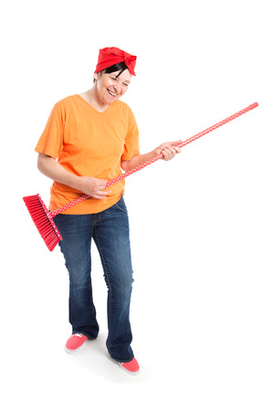 middle aged woman smiling: Middle aged woman smiling with dotted broom isolated on white Stock Photo