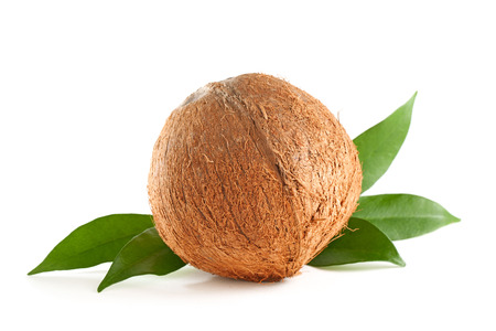 Whole coconut with leaves isolated on white