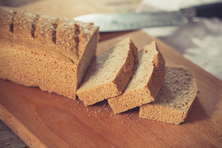 guar: Home baked gluten free bread on wooden board