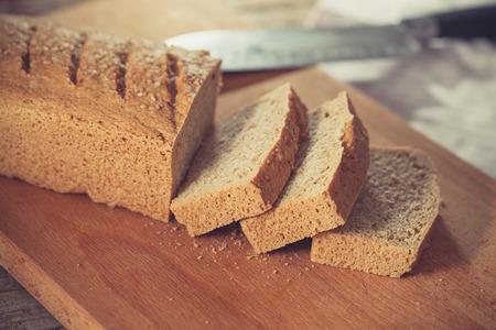 guar: Home baked gluten free bread on wooden board