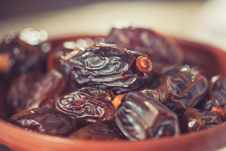 rustical: Extra sweet medjool dates in rustical bowl Stock Photo
