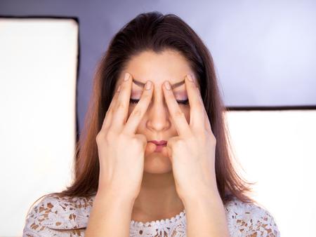 acupressure hands: Beautiful young caucasian woman doing face yoga