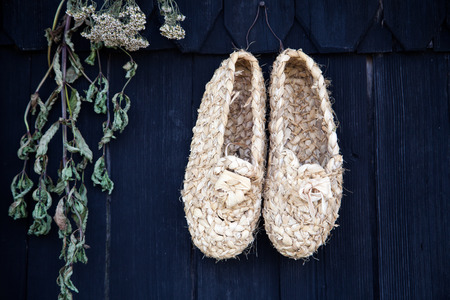 shepards: Shepards shoes on the wall of traditional house of Velika Planina, Slovenia, EU Stock Photo
