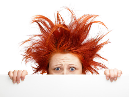 bad hair day: Woman with bad hair day isolated on white