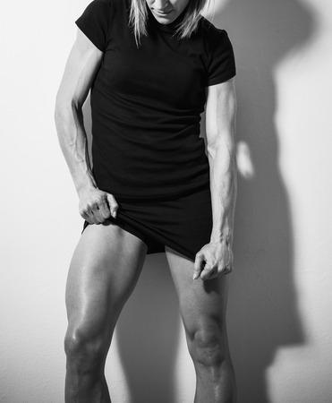 body torso: Torso of strong female body against white wall Stock Photo