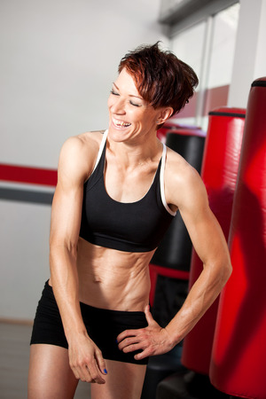 Happy fit woman after workout at the gym photo