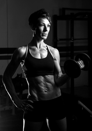 fit woman working out at the gym photo