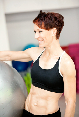 Fit woman with ball at the gym photo